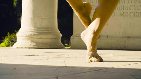 Bare feet of a woman dancing on a stone floor Archivo
