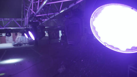 Metallic stage structure with equipment and mounted switched on spotlights Footage