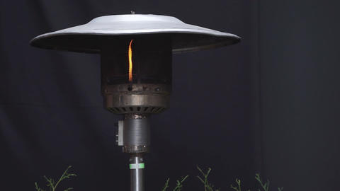 Gas flame flickering close-up in a modern-fashioned metallic street lamp Footage