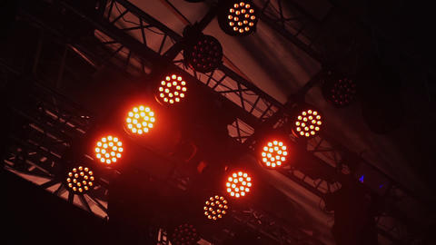 Ceiling area of stage structure with mounted switched on rows of red spotlights Footage