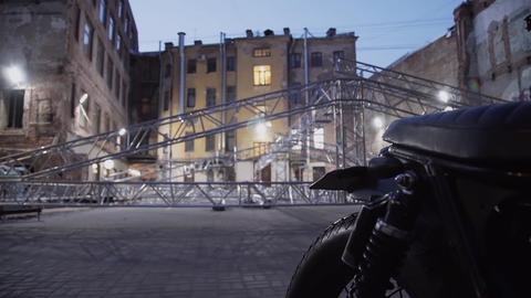 Motorcycle and framework of concert stage aluminium structure placed in street Footage