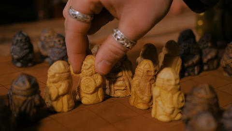 Man hand placing figures for medieval popular strategy board game - tafl Footage