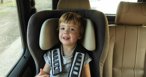 baby boy in the children's car seat in the car Footage
