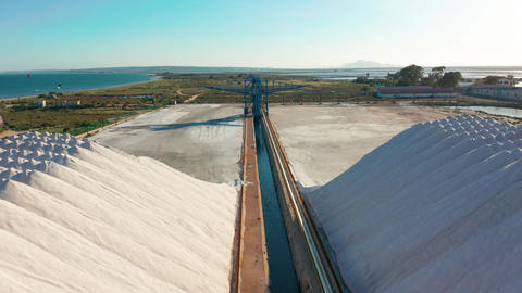 Aerial view of industrial extraction of salt in the desert, pile of salt Footage