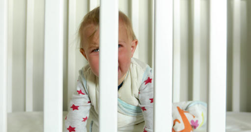 Crying baby in crib at home Live Action