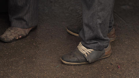 Beggar in old dirty shoes Footage