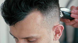 Extreme Close Up Face of Man in Hairdressing Salon. Barber Cuts Hair by Clipper Footage
