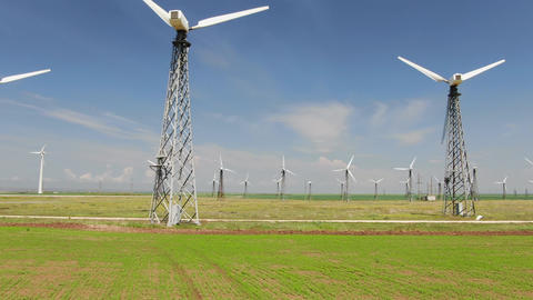 Row of towers with wind turbines in blue sky background Archivo