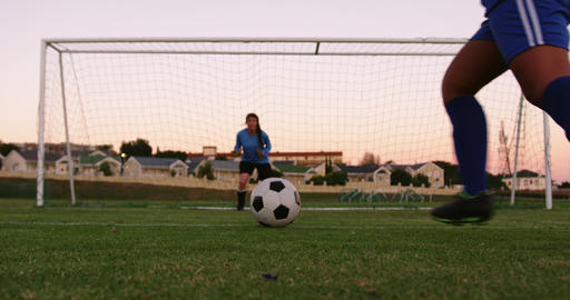 Female keeper waiting for female soccer player to shoot the ball. 4k Live Action