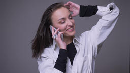 Closeup portrait of adult attractive caucasian female having a phone call and Footage