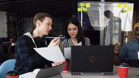 Three business partner working on the new business plan Footage