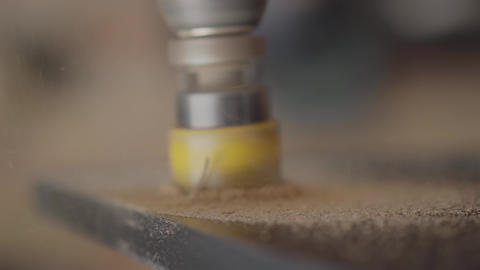 Close-up screwing holes with the tool in the wooden plate. Furniture manufacture Footage