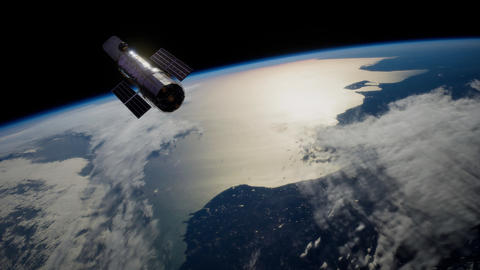 Hubble Space Telescope orbiting Earth. Elements of this image furnished by NASA Footage