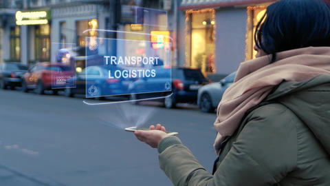 Woman interacts HUD hologram Transport logistics, Live Action
