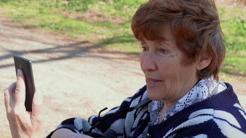 Talking via mobile video app senior woman, agree, disagree Footage