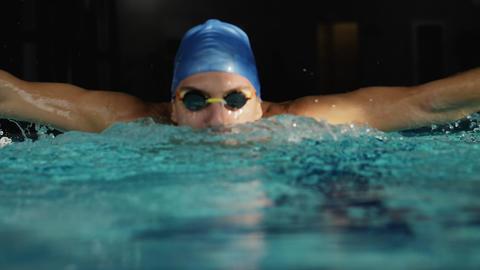 [alt video] Swimmer performing butterfly stroke. Slowmo