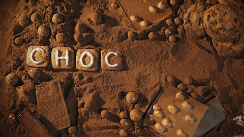 Stop motion chocolate message on the cocoa background Archivo