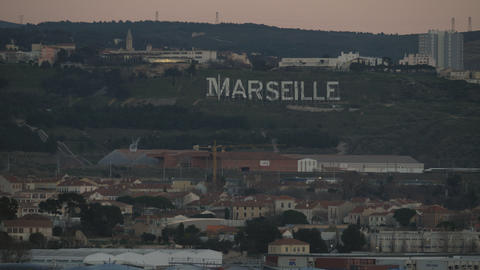 Marseille cityscape and sign on green hills, France GIF