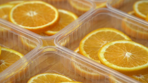 Rotate fresh citrus oranges fruits. Seamless loop spinning sliced oranges Live Action
