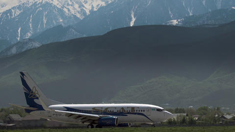 Boeing 737 of SCAT airlines. Scenery landscape with mountains Live Action