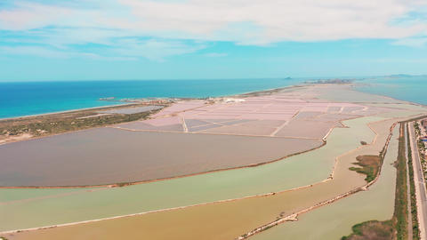 Multicolored salt lakes with coastal salt marshes, aerial view, video shooting Live Action