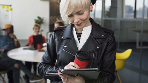 Attractive business woman working on the tablet with group of young business Footage