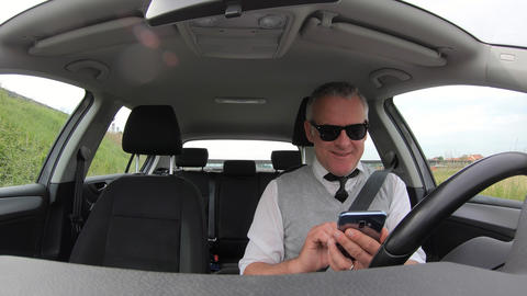 Car Driver Man Using Smartphone For Internet Email Social Media Footage