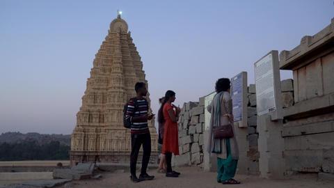 Tourists read the description Footage