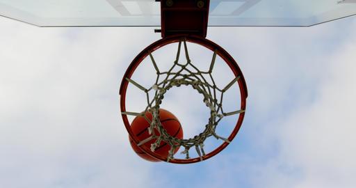 Basketball going through basketball hoop 4k Live Action