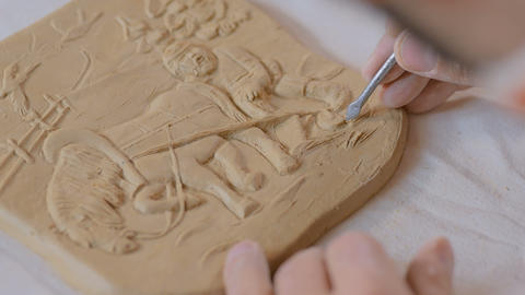 Potter making clay stamp picture GIF