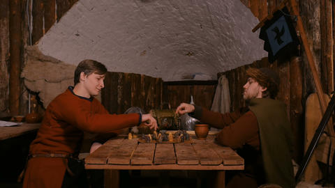 Two men playing popular strategy board game - tafl GIF