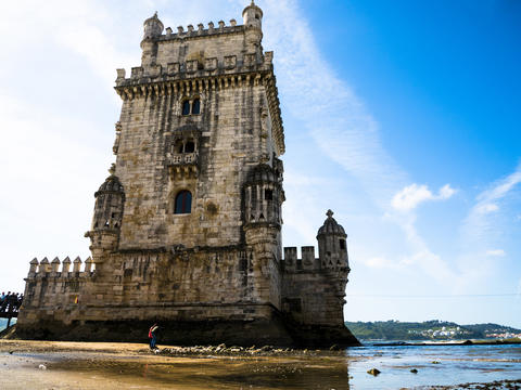 view of the tower of Belem, Tagus river, clear day and blue sky, Lisbon Photo