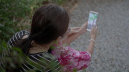 Happy Asian Family Taking Selfie With Smartphone On A Outdoor Swing Footage