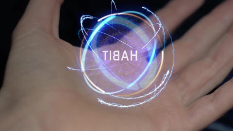 Habit text hologram on a female hand Live Action