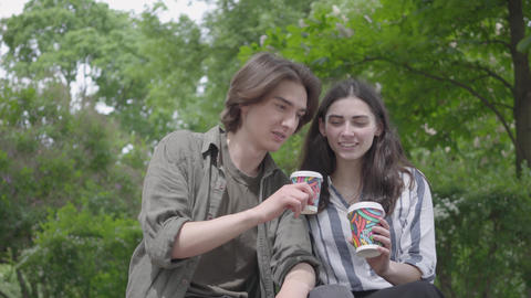 Portrait adorable young cute couple in casual clothes spending time together in Footage