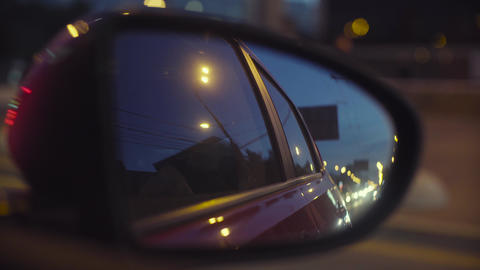 Blurred traffic lights in rearview mirror Footage