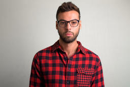 Young handsome bearded hipster man wearing eyeglasses Photo