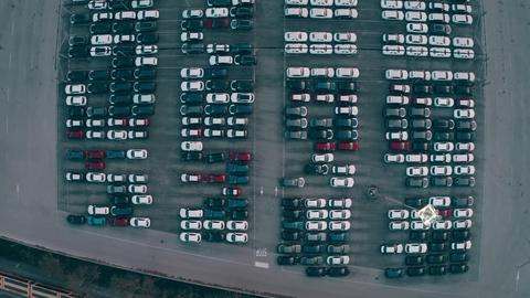 Aerial top down view of a big automotive factory new cars storage Photo