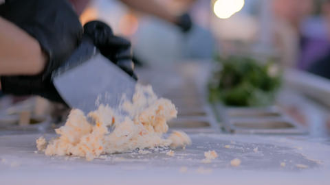Preparing hand made natural stir-fried ice cream GIF