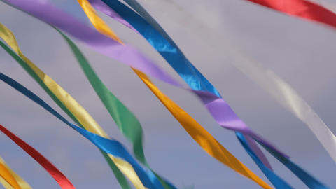 Decorative multicolor ribbons waving in the wind GIF