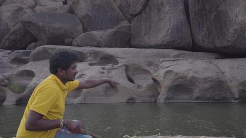 River in an Indian village with destroyed buildings Acción en vivo