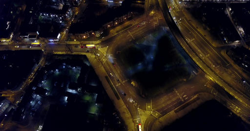 Aerial 4K night view of a Bricklayers Arms round about Footage