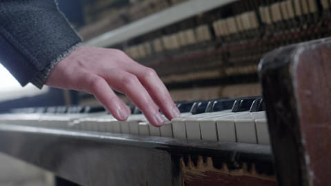 Man's hand is pressing keys of old, dusty and abandoned classic wooden piano Footage