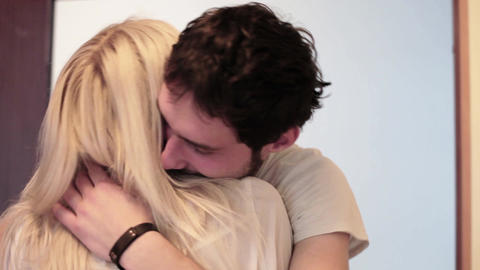 Young nice-looking dark haired man is hugging long haired blonde woman at Live Action