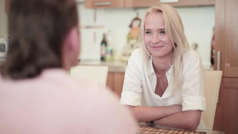 Young man and woman are having nice, friendly and warm conversation in kitchen Footage