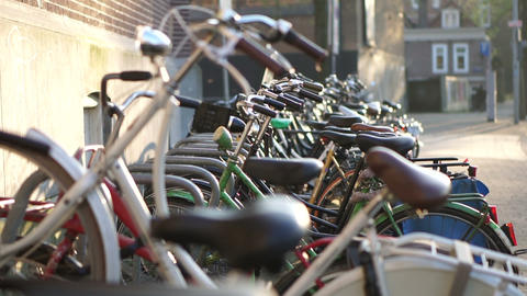 People and bicycles in Amsterdam. Eco friendly lifestyle transportation of Netherland people Footage
