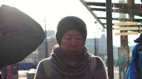 Asian family backpacker morning tram train transportation, Europe trip. Shot in slow motion Footage