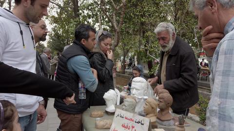 Tehran, Iran - 2019-04-03 - Street Artist Sells Sculptures Live Action