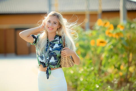 beautiful blonde in the garden of a sunny summer day Photo