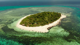 Tropical island with sandy beach. Mantigue Island, Philippines Footage